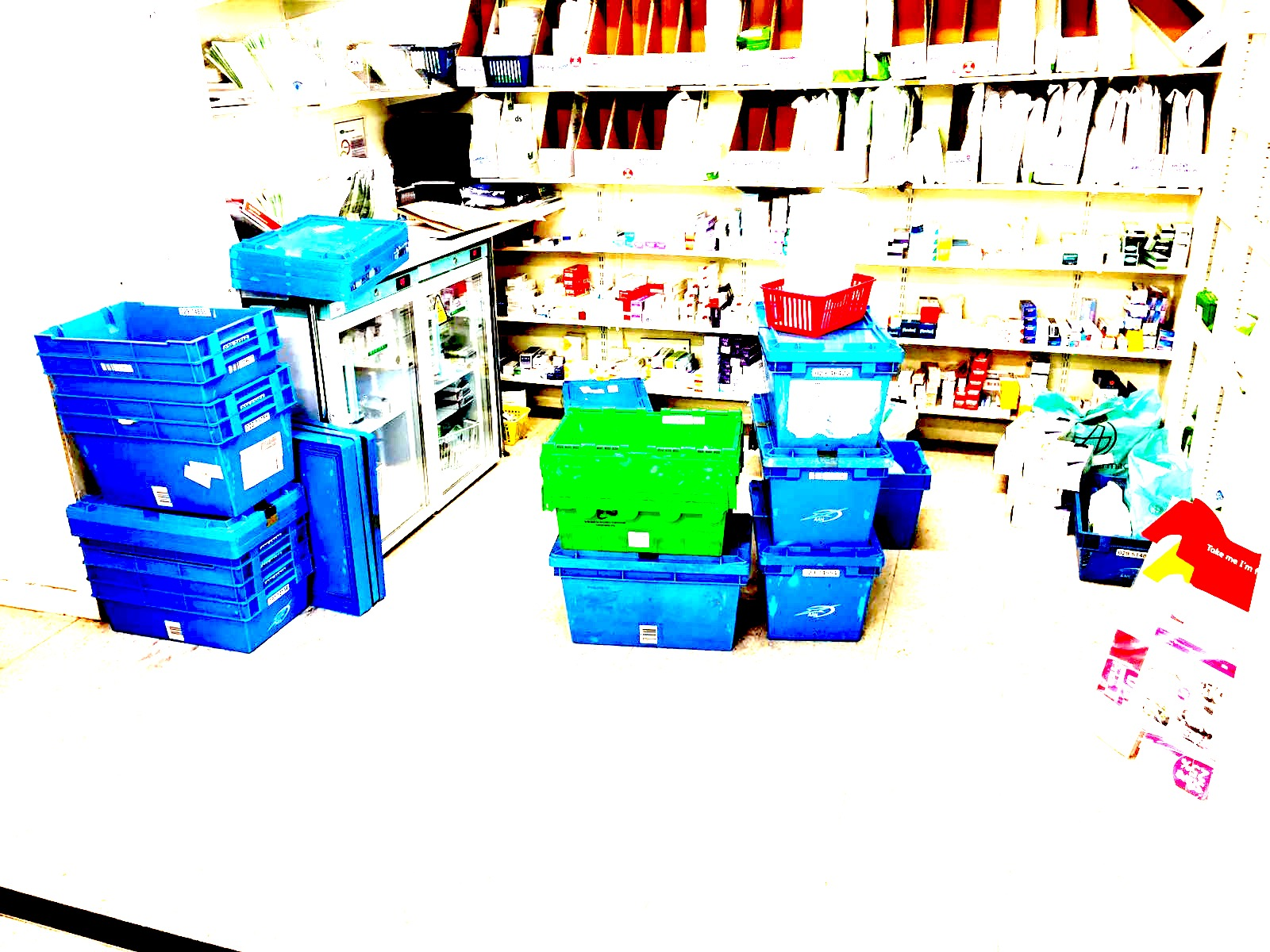 untidy community pharmacy with stock delivery on the floor