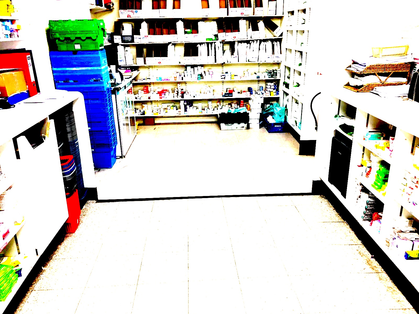 Tidy community pharmacist with blue totes neatly arranged